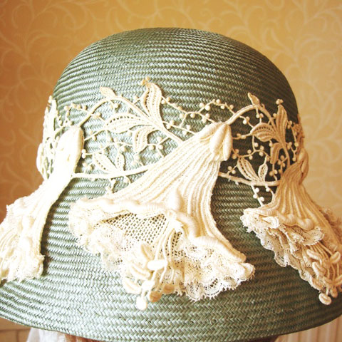 Pale green straw hat detail